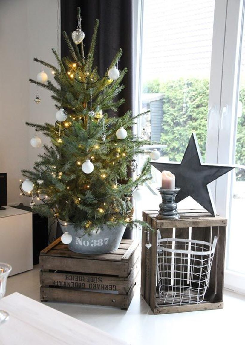 17-a-small-tree-in-a-galvanized-bucket-with-lights-and-white-ornaments-is-a-great-rustic-idea-for-christmas
