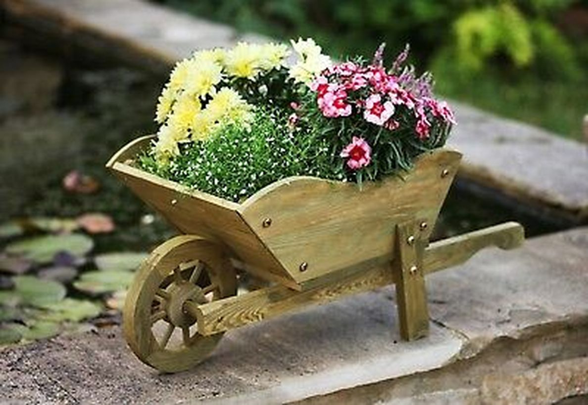A-small-wooden-train-coupled-with-colorful-flower-plants-that-are-very-charming