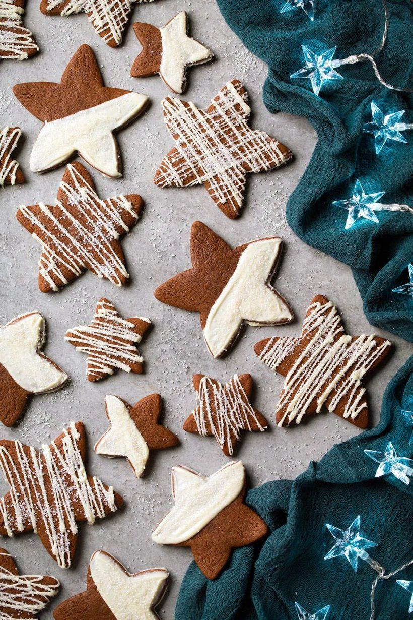 Classic-christmas-décor-ideas-with-white-chocolate-gingerbread-star-cookies.-feel-free-to-add-as-much-or-as-little-as-youd-like.