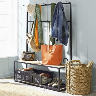 Laundry-basket-storage-under-entryway-bench-seat-with-clothing-and-coat-hooks-beside-rattan-umbrella-stand-ideas-783x783