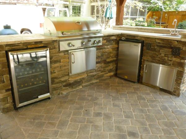 1-kitchen-with-wine-refrigerator-grill-and-travertine-counter-top-copy