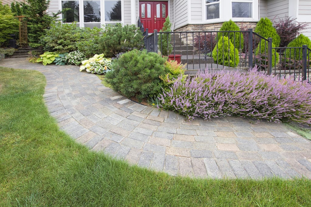 3-bigstock-front-yard-garden-curve-paver-49457666