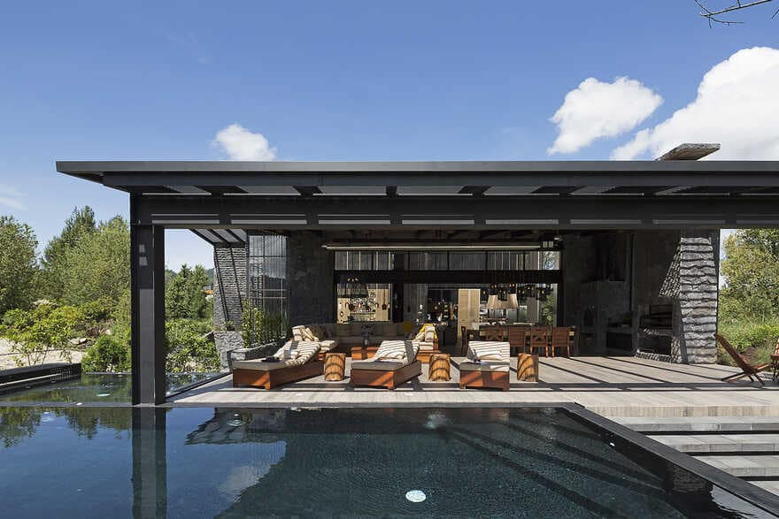 Dark grey house in modern construction of purified lines with rustic touches 2