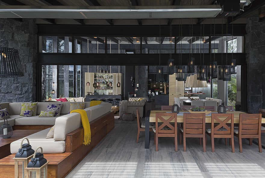 Dark grey house in modern construction of purified lines with rustic touches 3