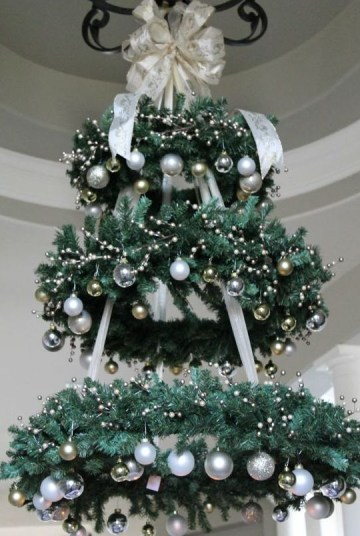 02-a-chandelier-made-of-faux-evergreen-wreaths-and-silver-and-gold-ornaments