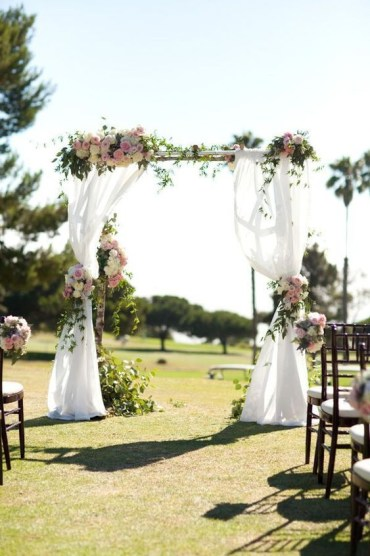 02-country-chic-wedding-arch-with-white-fabric-and-pink-flowers