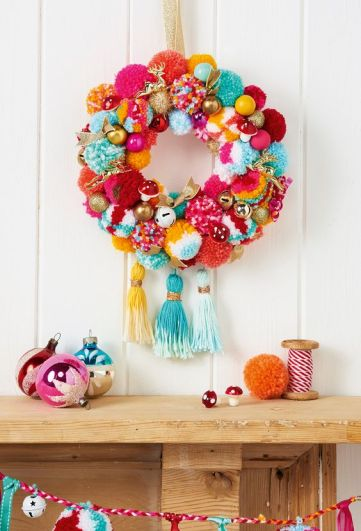 03-a-super-colorful-and-whimsy-holiday-wreath-with-pompoms-ornaments-fake-mushrooms-and-large-tassels