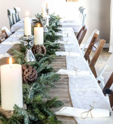 07-a-burlap-table-runner-an-evergreen-garland-candles-and-large-pinecones-for-a-cozy-rustic-feel