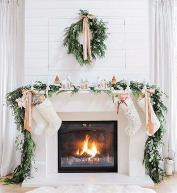 1-03-evergreen-garland-and-wreath-bows-and-small-houses-make-the-fireplace-very-cozy