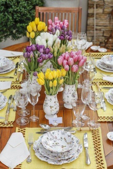 1 a-colorful-spring-tablescape-with-bright-yellow-placemats-prited-floral-porcelain-and-lots-of-colorful-tulips
