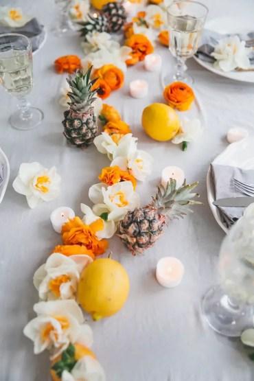 1 orange-white-flowers-table-runner-lemons-pineapples-dining-table-decor-ideas-candles