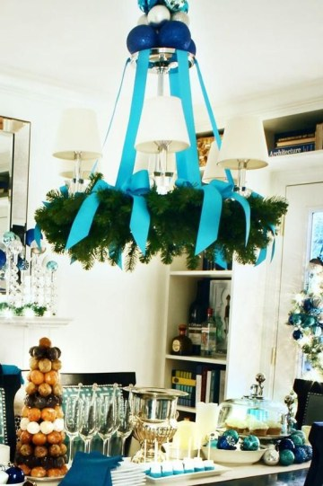12-a-usual-chandelier-covered-with-an-evergreen-wreath-and-turquouse-ribbon