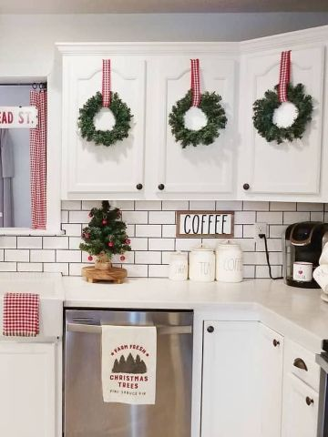 2-christmas-wreaths-on-kitchen-cabinets-@ourcozycottage