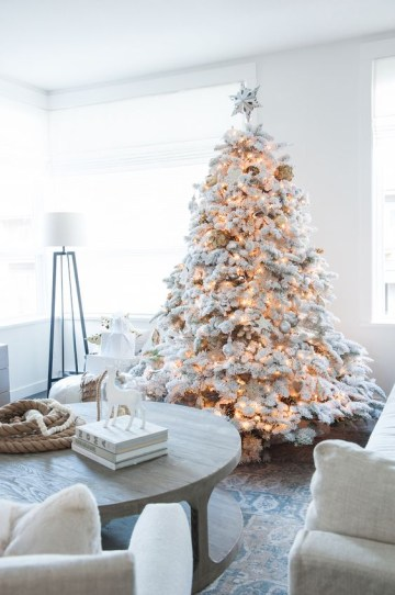 21-flocked-christmas-tree-with-white-ornaments-and-lights