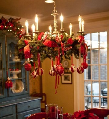 24-decorate-a-usual-chandelier-with-evergreen-branches-red-ribbon-and-ornaments