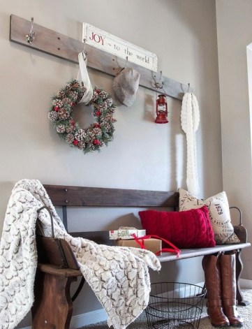 25-pinecone-wreath-a-warm-throw-and-red-color-for-a-stylish-and-warming-up-winter-look