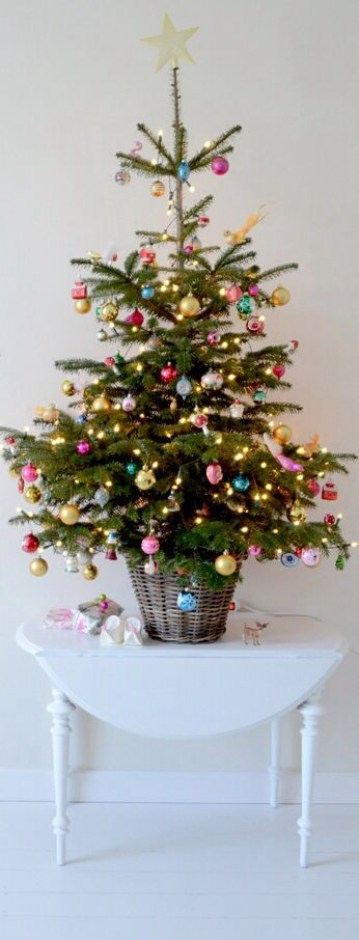3 04-a-small-traditional-christmas-tree-decorated-with-colorful-ornaments