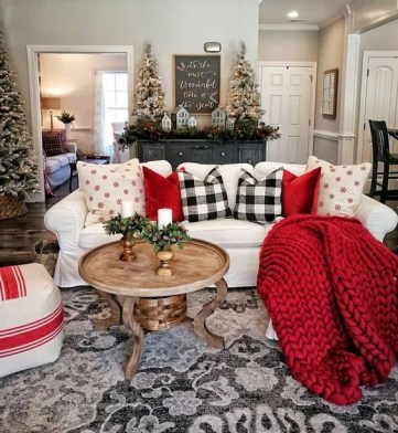 Red-pillows-and-a-blanket-plaid-pillows-give-the-living-room-a-holiday-spirit-and-make-it-lively