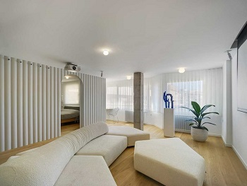 Contemporay white apartment with an open living space that feels dramatic 2