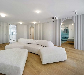 Contemporary white apartment with an open living space that feels dramatic 4
