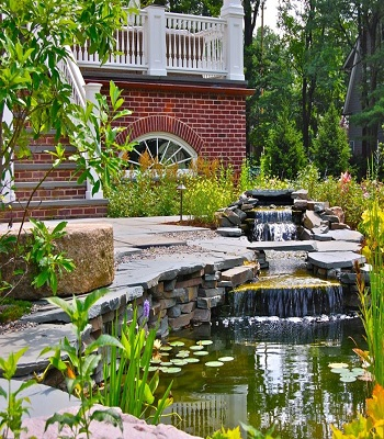 Home entrance accented by pond Innovative Landscape Ideas For Water Features To Create A New Look