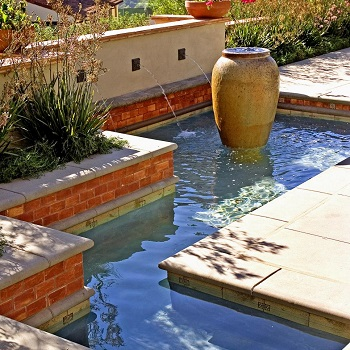 Urn-like fountain in a garden pool Innovative Landscape Ideas For Water Features To Create A New Look
