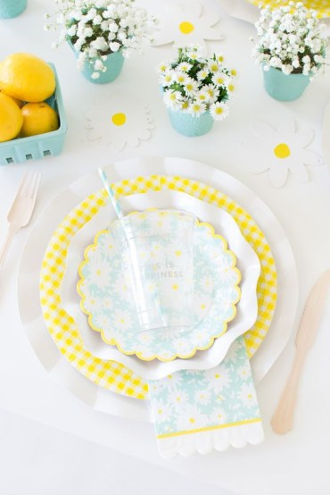 A-colorful-spring-table-setting-with-dairy-and-babys-breath-centerpieces-yellow-and-white-porcelain-and-touches-of-turquoise