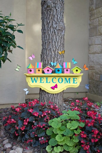 Cheery birdhouse welcome sign