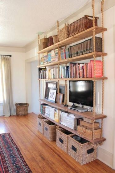 4-16-a-large-hanging-shelving-unit-with-thick-rustic-wooden-shelves-and-thick-ropes-plus-baskets-under-it-for-more-organization