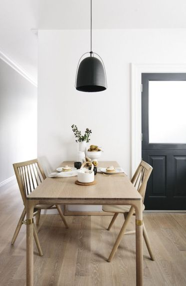 7-scandinavian-dining-room-with-warm-natural-wood-dining-table-and-black-pendant-light-via-luft-1