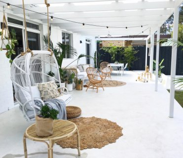 White-patio-design-with-hanging-chair