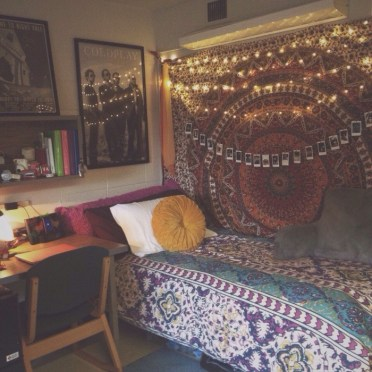 Boho-style-teen-bedrooms-colorful-mandala-fabric-wall-hanging-decorated-with-lit-fairy-lights-and-polaroid-photos-on-a-string-near-a-single-bed-with-multicolored-patterned-bed-covers
