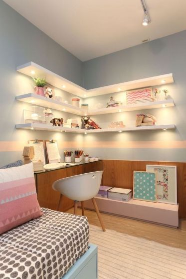 Bookshelves-with-led-lights-on-light-blue-wall-above-desk-teenage-girl-bedroom-ideas-wooden-floor-pink-throw-pillows-on-the-bed-1