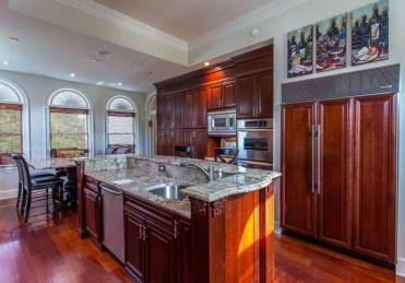 Classic-wood-kitchen-with-custom-granite-island