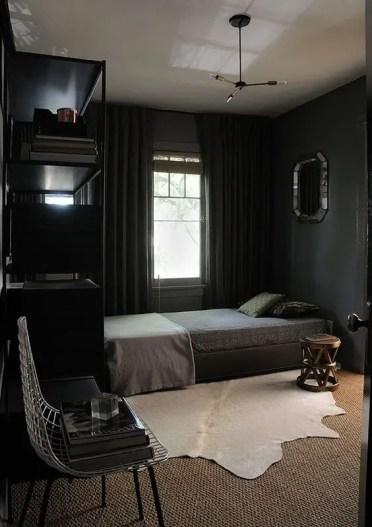 Cozy-bedroom-in-black-with-textural-textiles