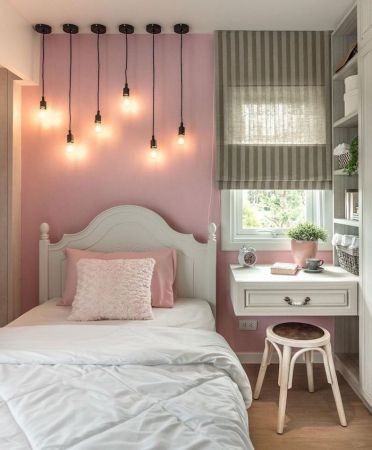 Floating-desk-next-to-the-bed-teenage-girl-bedroom-ideas-for-small-rooms-pink-wall-with-hanging-lamps-with-different-length-above-the-bed