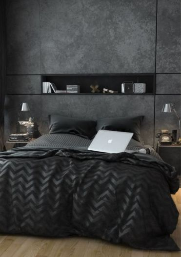 Modern-bedroom-with-a-wall-niche-mirror-nighstands-and-cool-black-bedding