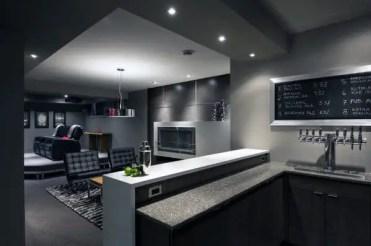Modern-grey-walls-basement-man-cave-with-bar-design