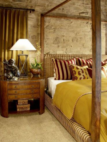 1-it-is-the-stone-wall-that-brings-an-air-of-authenticity-to-this-mediterranean-bedroom