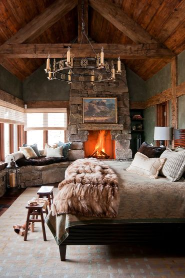 1-love1ly-stone-wall-fireplace-and-window-seat-enhance-the-woodsy-cabin-style-of-the-bedroom