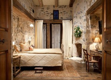 1-warmth-of-the-stone-brings-a-dash-of-timelessness-to-the-comfy-bedroom-1