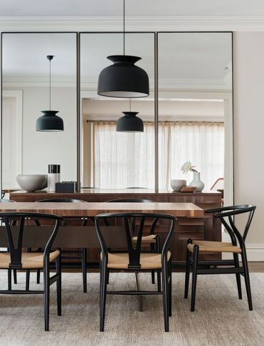 2-12-a-trio-of-three-tall-mirrors-makes-the-dining-room-look-bigger