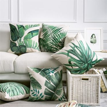 3-02-a-selection-of-torpical-leaf-print-pillows-is-a-budget-savvy-way-to-brighten-up-the-space