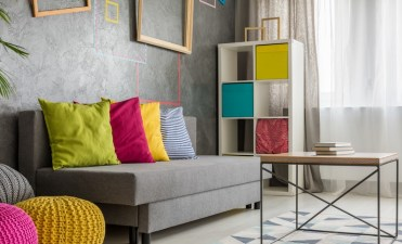 Grey couch with colored cushion