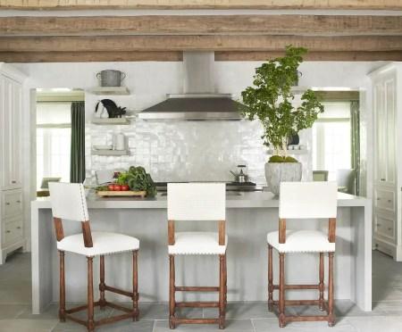Kitchen with glossy tile backsplash