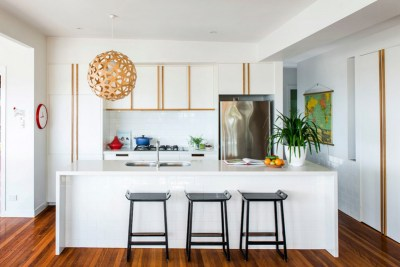 Kitchen with a wooden pendant light