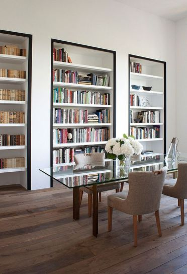 A-super-refined-home-office-with-built-in-bookshelves-with-black-framing-to-accent-them-as-much-as-possible-3
