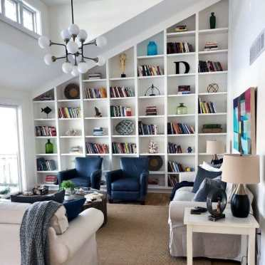 Floor-to-ceiling-angeled-built-in-bookcase-ideas-for-living-room