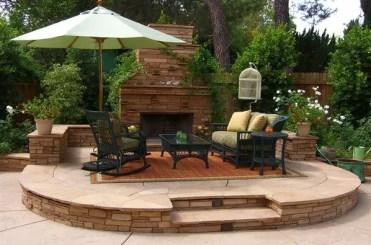 Garden-sun-protection-ideas-outdoor-umbrella-outdoor-stone-fireplace