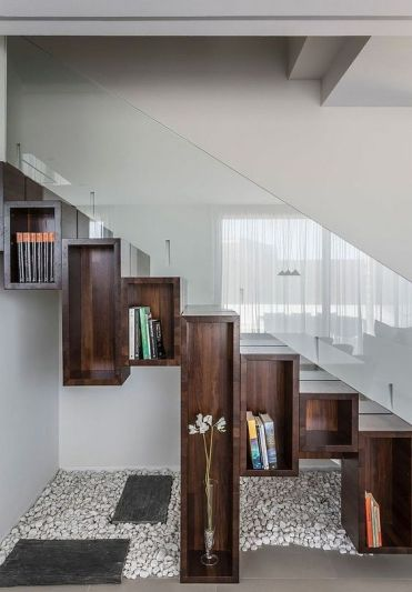 Whimsy-dark-stained-open-box-shelves-form-steps-and-give-storage-space-at-the-same-time